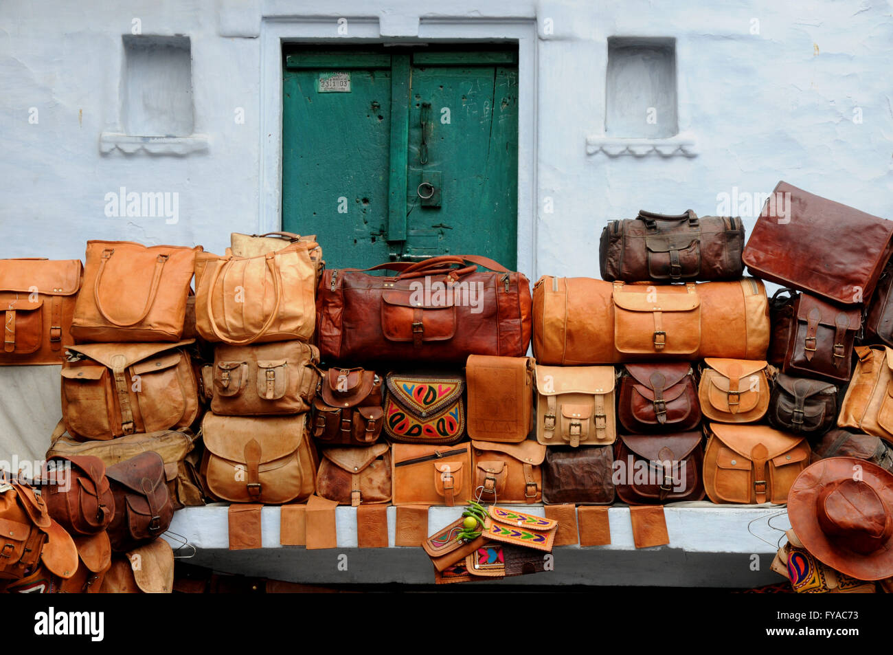 Colourful leather bags for sale on a stall in the Rajasthani city ...