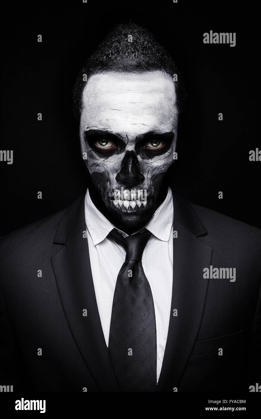 handsome men with skull makeup and suit and tie stock