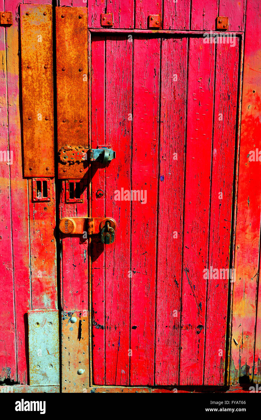 Old red wooden door with Chubb lock & Old red wooden door with Chubb lock Stock Photo Royalty Free ...