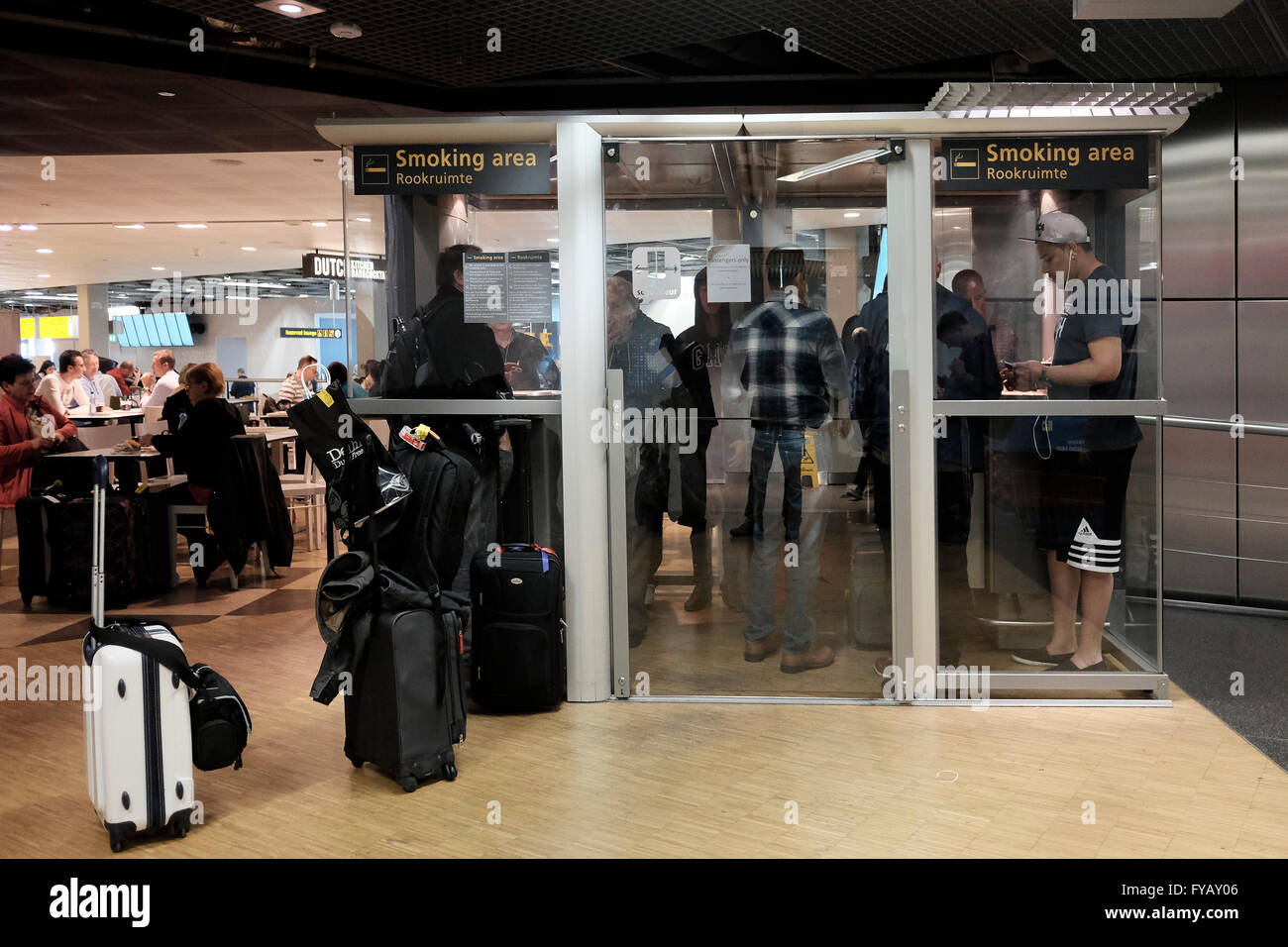smoking room in schiphol airport amsterdam holland stock image