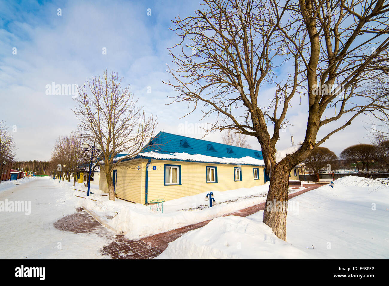 Small Yellow Wooden Cottage In Winter Stock Photo Royalty