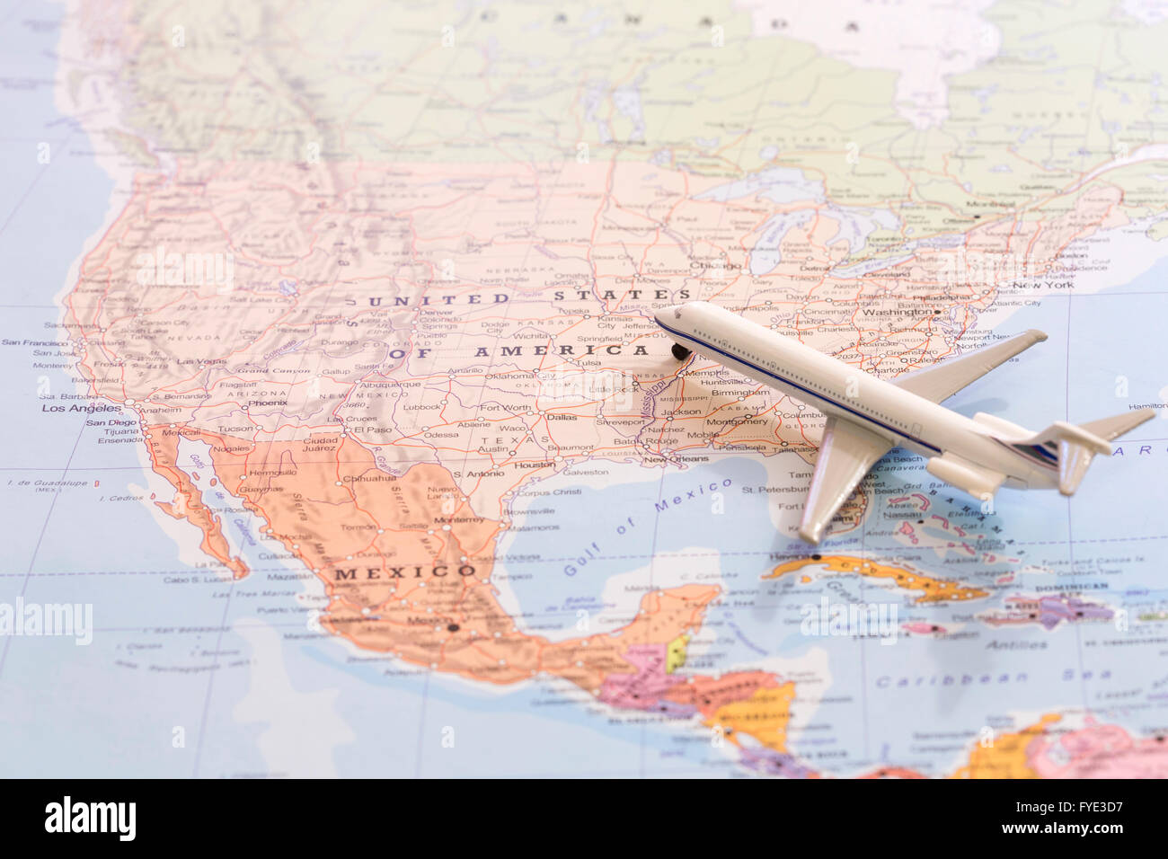 Miniature Of A Passenger Plane Flying On The Map Of United States Of America From South East Conceptual Image For Tourism And T