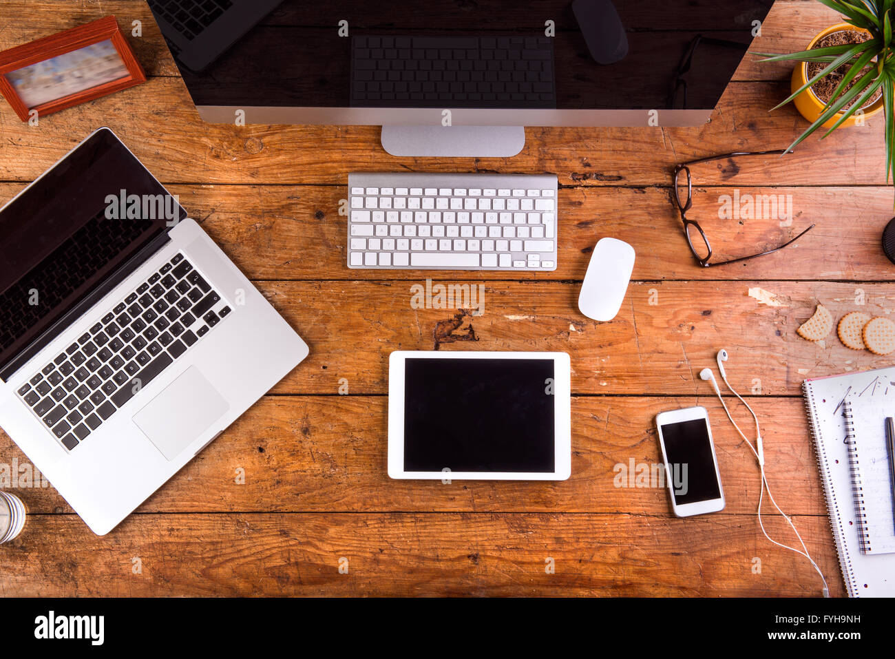 desk, gadgets and office supplies. flat lay. wooden background