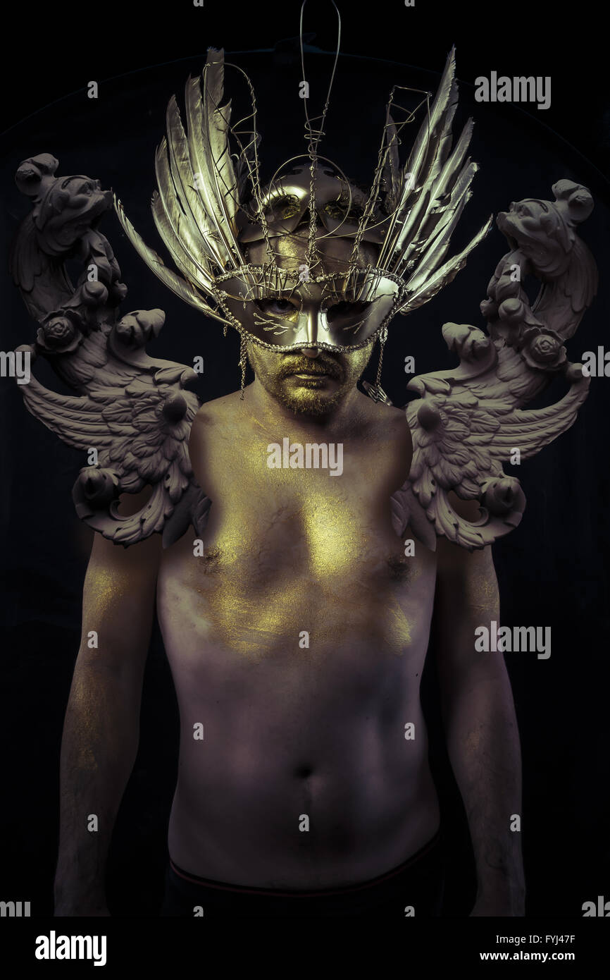 armor warrior or ancient god with golden mask and sword
