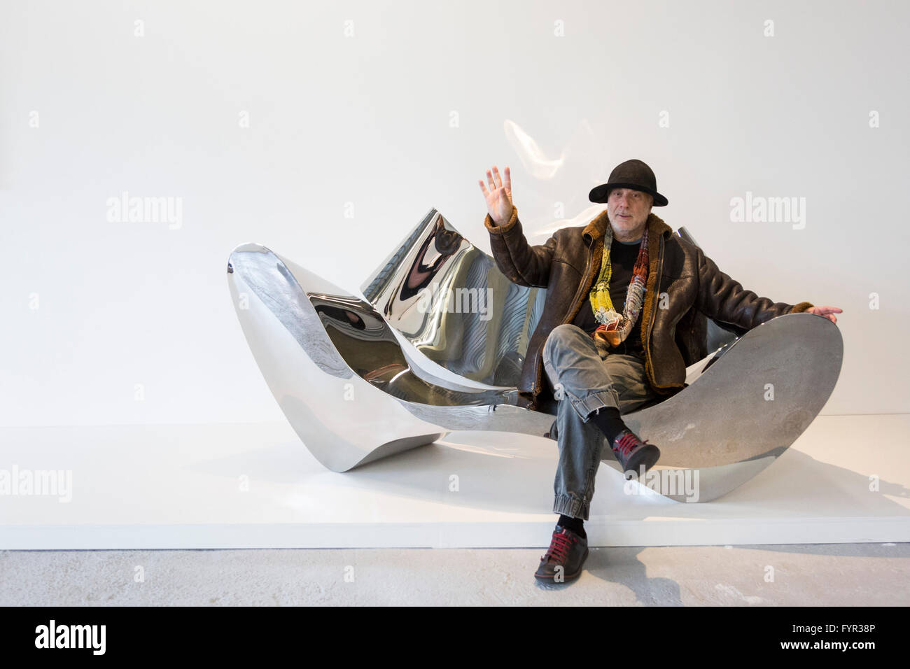 Designer Ron Arad Sits On The Polished Stainless Steel D Sofa, 1994, Which  He Designed. Donated For The Auction By Johannes And Helene Huth.