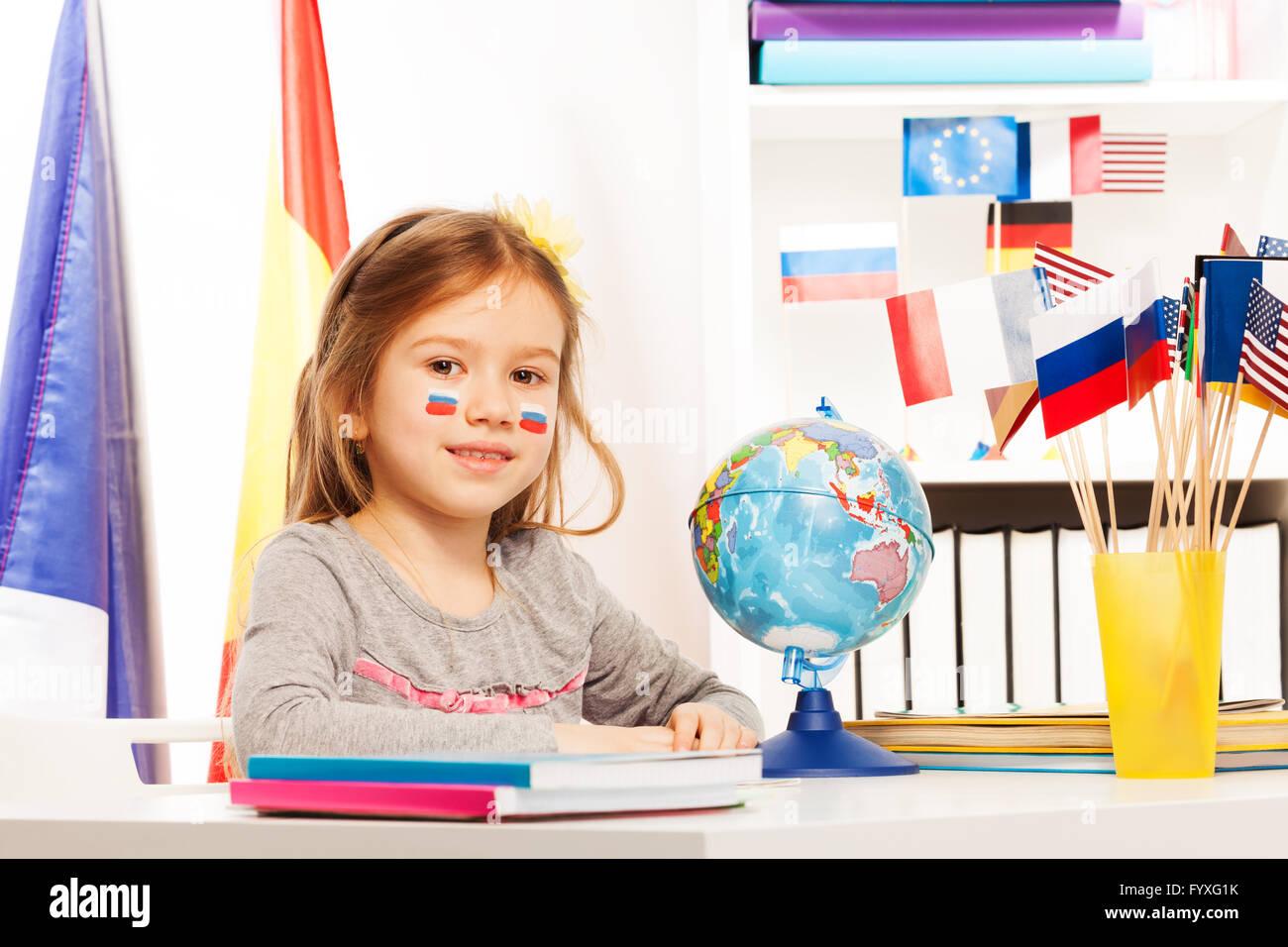 russian schoolgirl Russian schoolgirl sitting at a desk in classroom