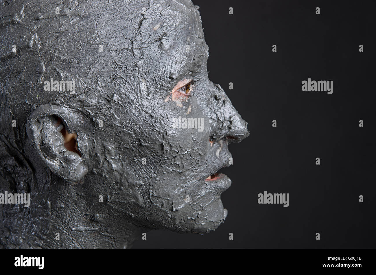 Statuesque woman in wet clay. Woman covered in wet clay. Spa Stock ...