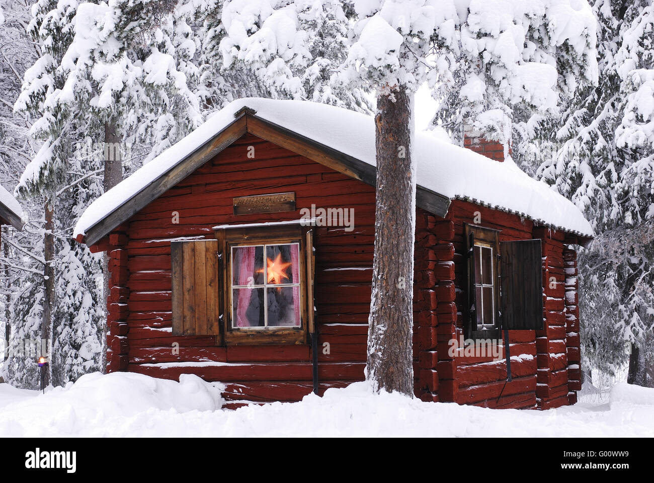 Snowy Log Cabin ~ Cabin in snowy forest stock photo royalty free image
