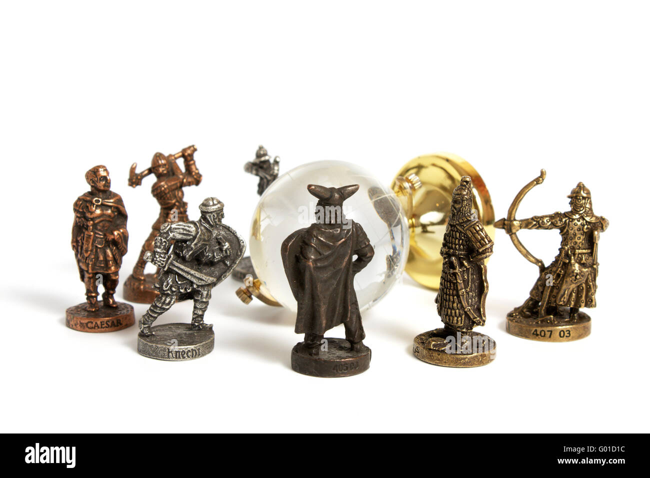 metal figurines of ancient warriors around glass globe isolated on  - stock photo  metal figurines of ancient warriors around glass globeisolated on white concept of military history