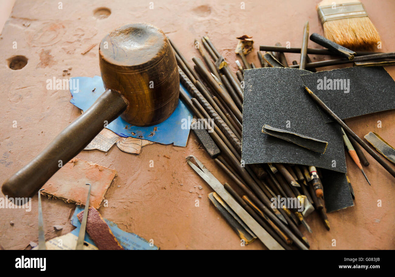 Stock Photo   Various Kinds Of Sculpting Tools Laying Down On Dirty Wooden  Table