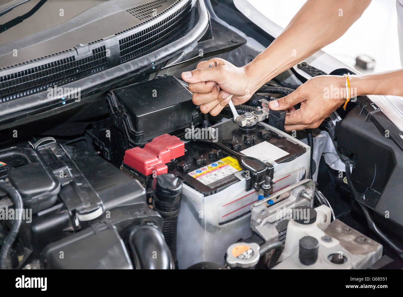 Where is the battery in a car - Mechanic Engineer Fixing Car Battery In Garage Selective Focus