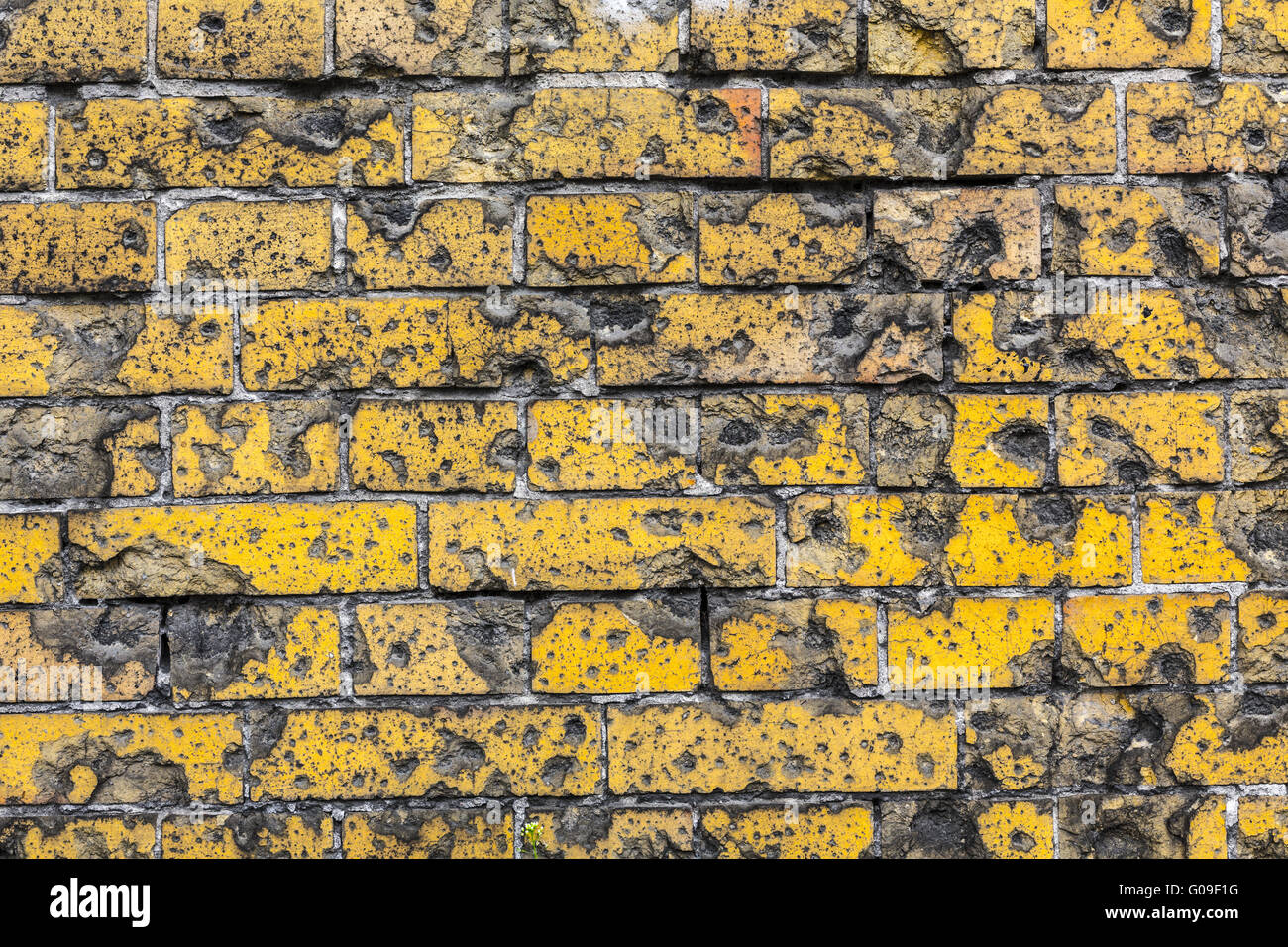 Vintage Red Brick Wall Background With Bullet Holes From WW2