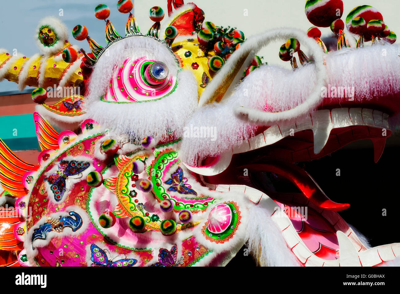 profile of chinese dragon head outdoors parade stock photo