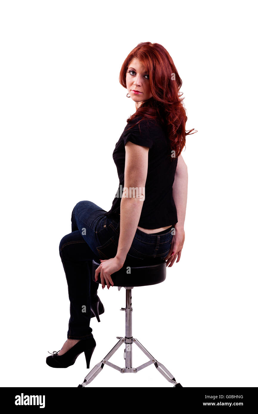 Caucasian Woman Sitting On Stool Jeans Redhead Stock Photo Royalty Free Image 103517612 Alamy