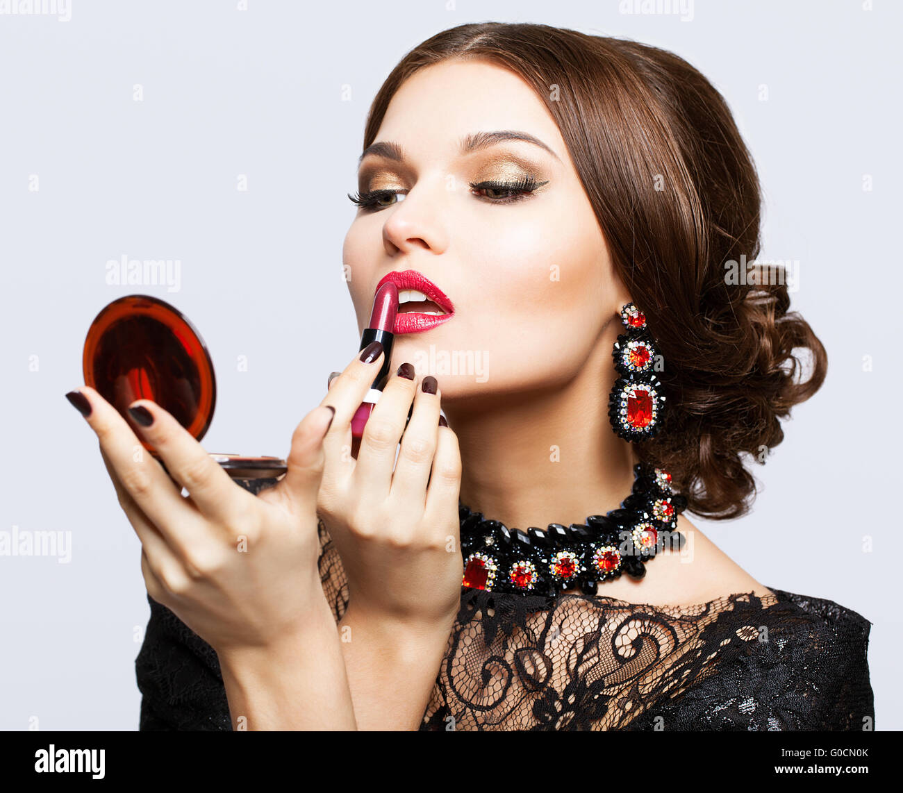 Black dress lipstick - Makeup Of Young Beautiful Brunette Woman In Black Dress With Lipstick And Mirror In Hands
