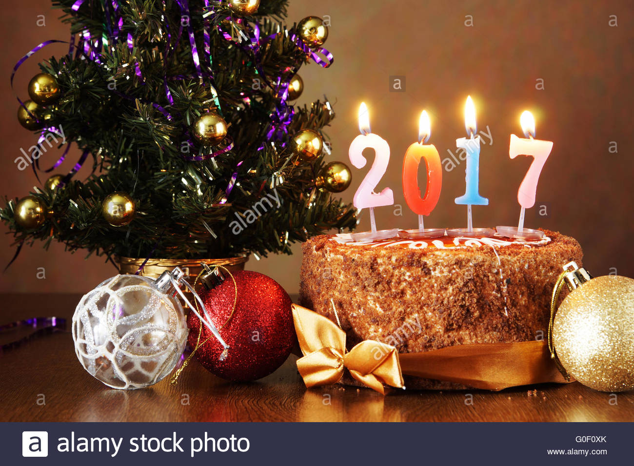 Christmas Cake Design 2018 : New Year 2017 still life. Chocolate cake and artificial ...