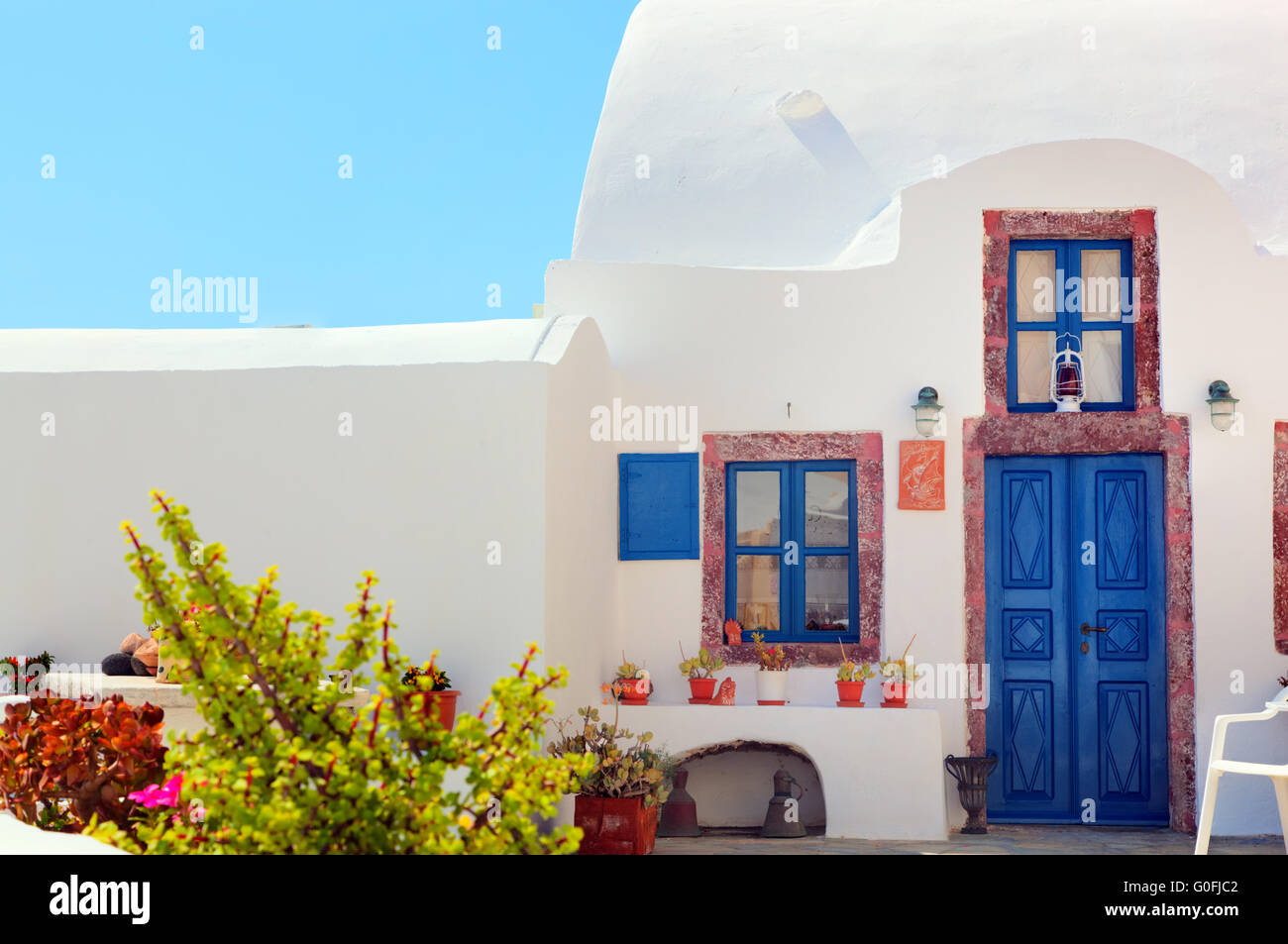 Traditional Greek House traditional greek house with blue door and windows stock photo