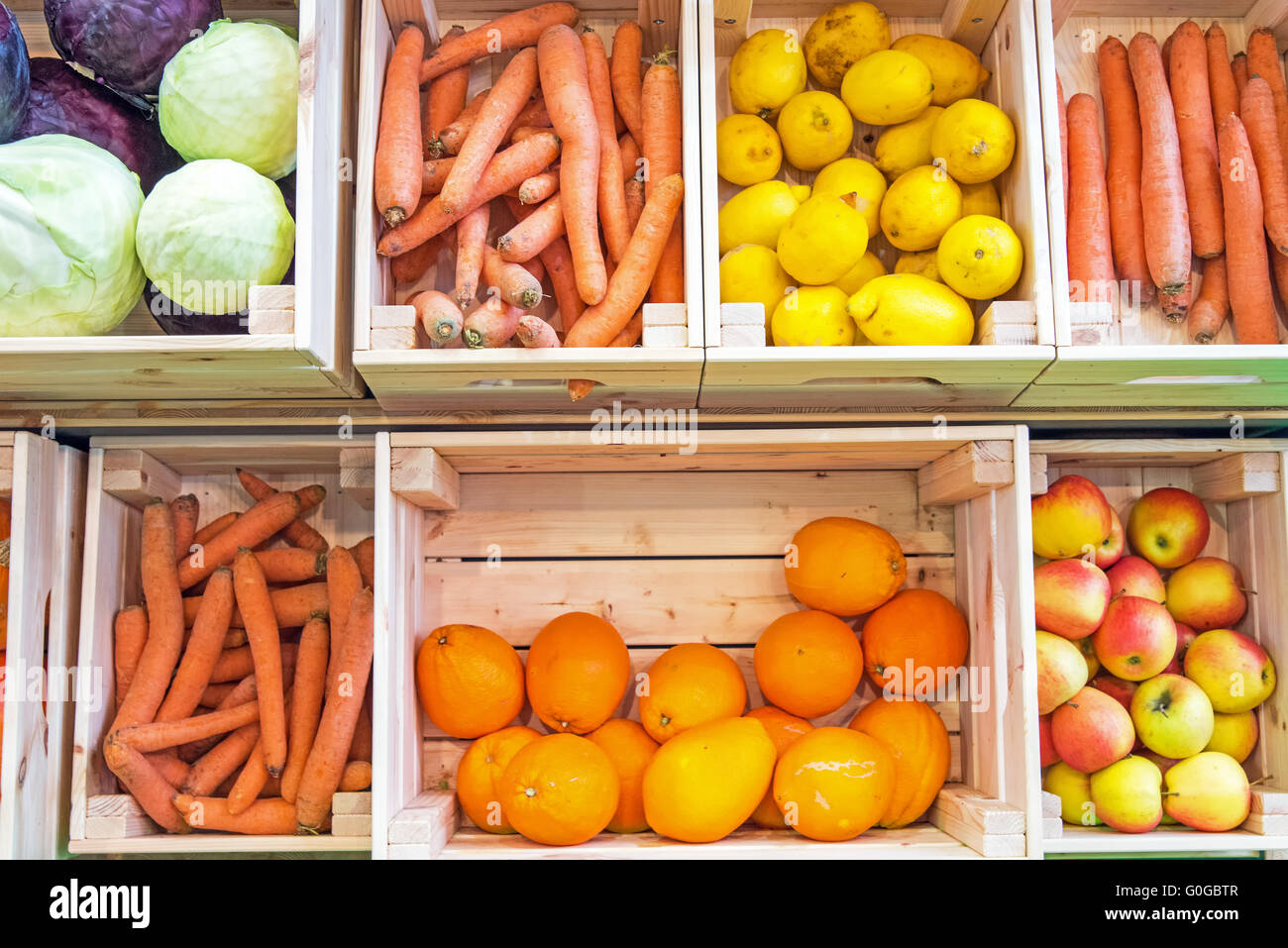 Fruits And Vegetables In Wooden Boxes For Sale At A Market