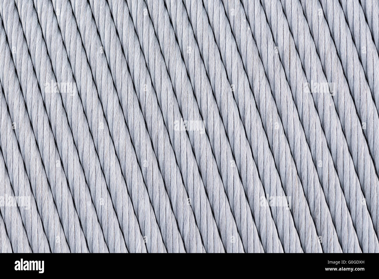 big thick metal wire is wound on the spool abstract background Stock ...