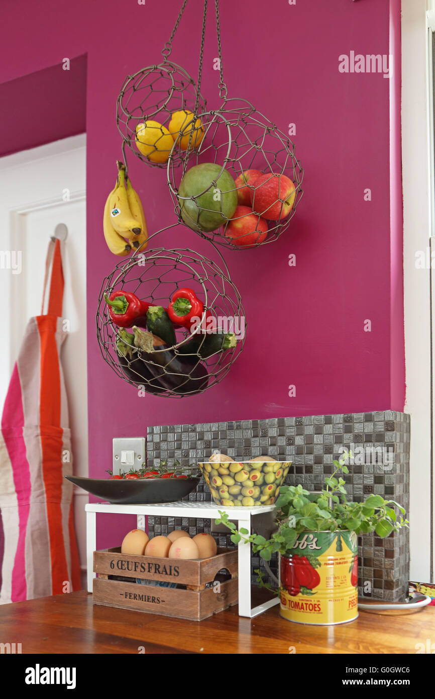 Fruit And Vegetables Stored In Hanging Mesh Baskets In A