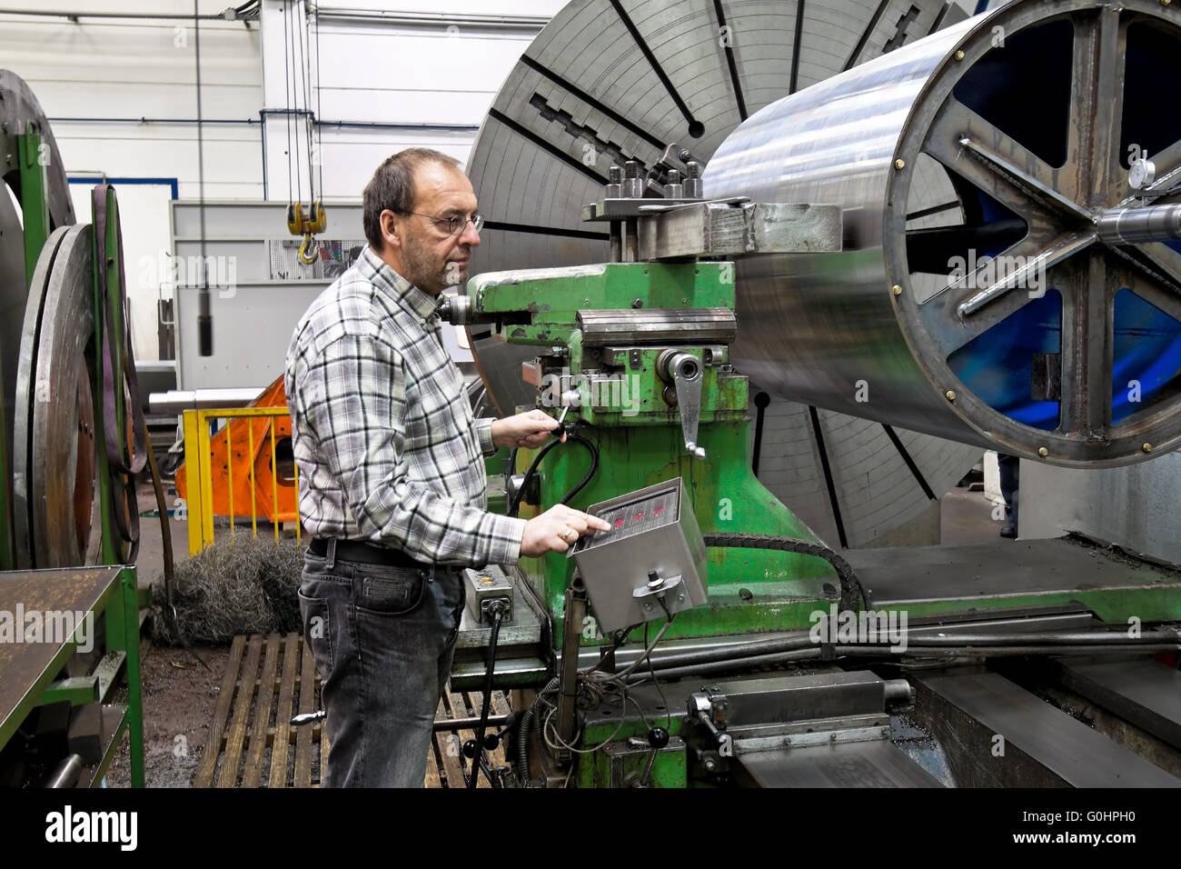older workers in the metal industry in cnc milling machine stock older workers in the metal industry in cnc milling machine