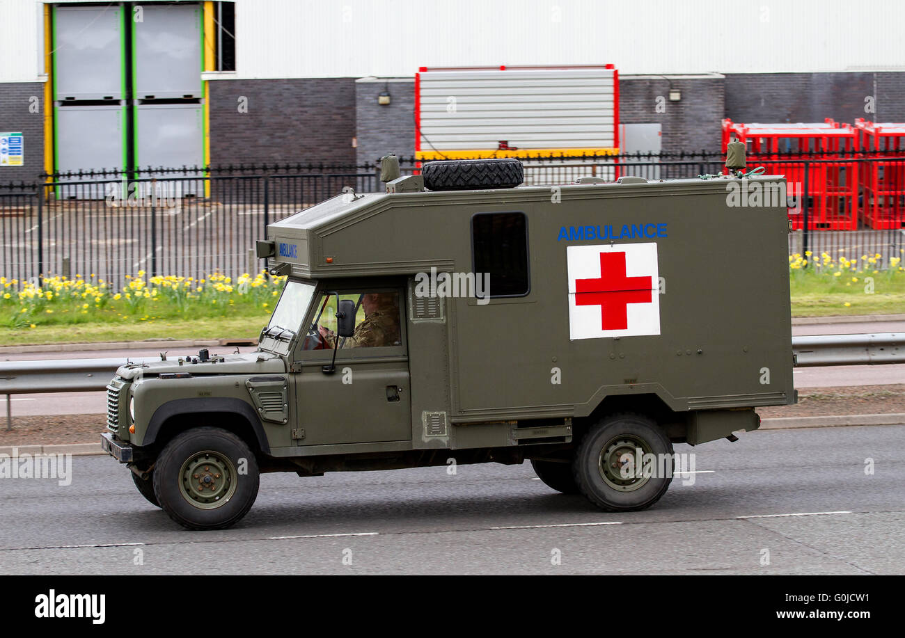 A british army battlefield ambulance land rover travelling along the kingsway west dual carriageway in dundee