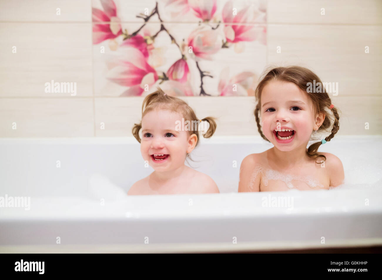 Two little girls having bath with - 83.2KB