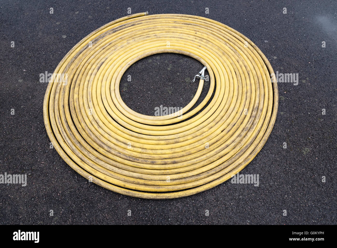Coil yellow water hose Stock Photo: 103701097 - Alamy