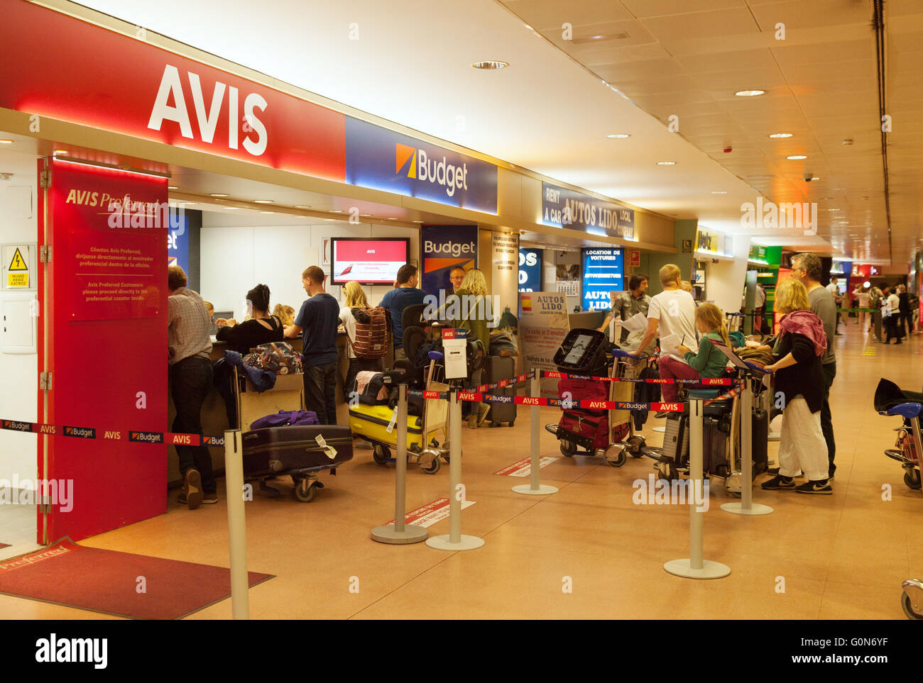 Holiday makers queue at car rental desks malaga airport costa del sol spain