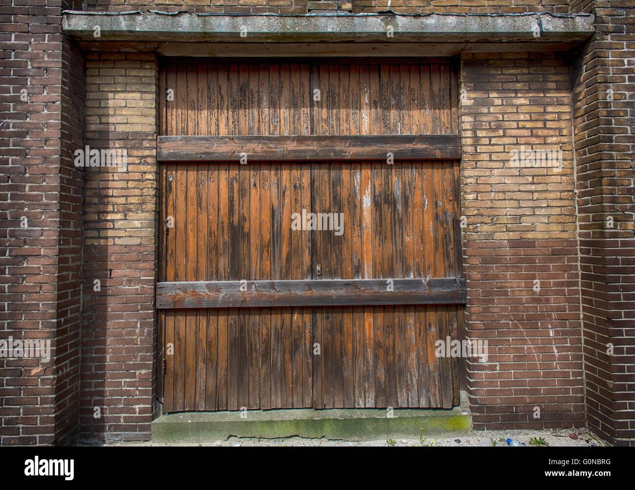 Stock Photo   Weathered Wooden Warehouse Door