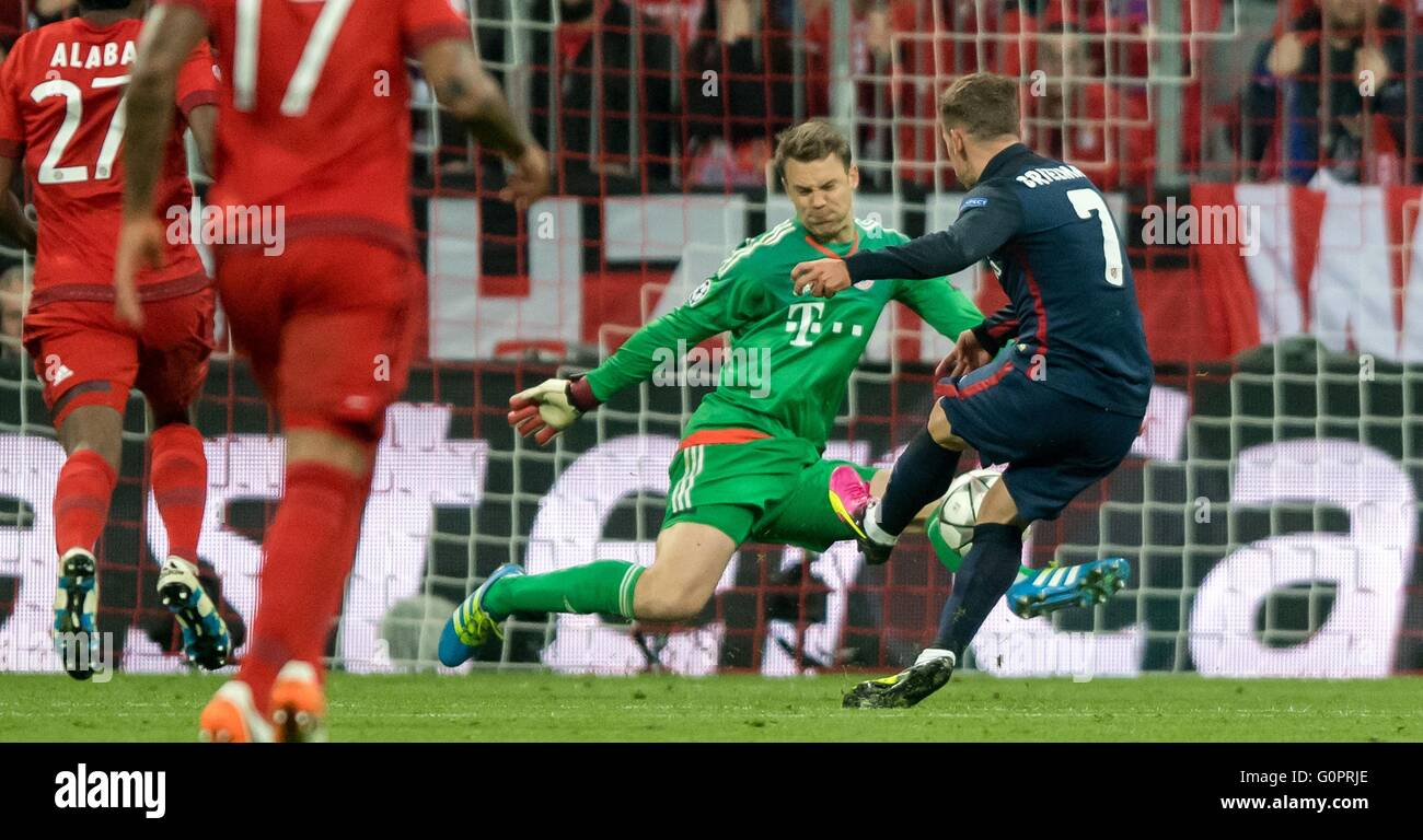 Bayern Munich s goalkeeper Manuel Neuer l and Madrid s Antoine