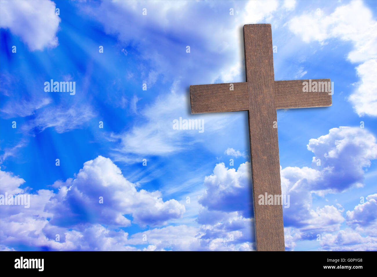 the cross of jesus christ and beautiful clouds stock photo