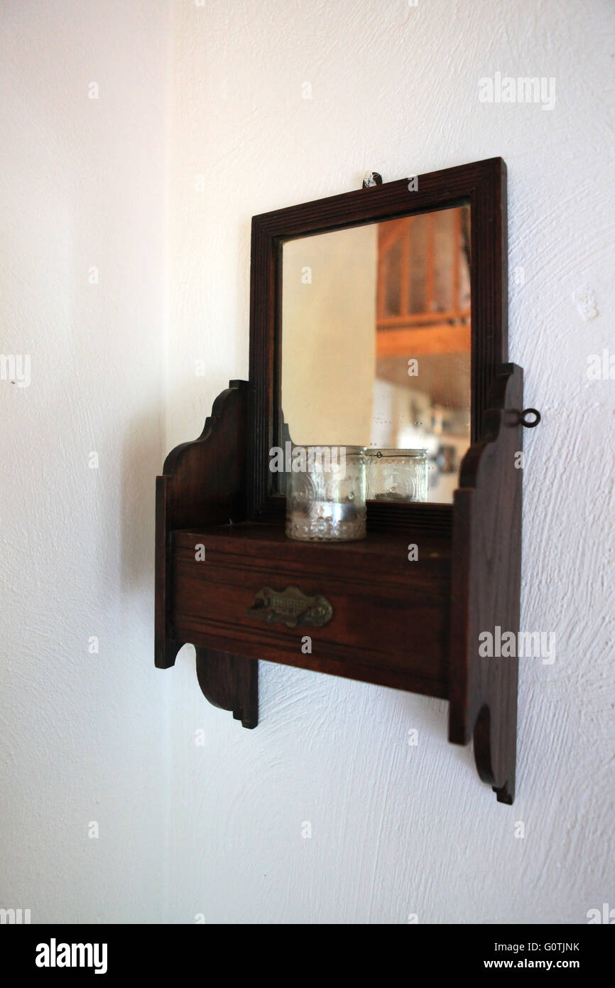 Old vintage antique wooden mirror on a wall in a bedroom in a old vintage antique wooden mirror on a wall in a bedroom in a cottage in ireland amipublicfo Gallery