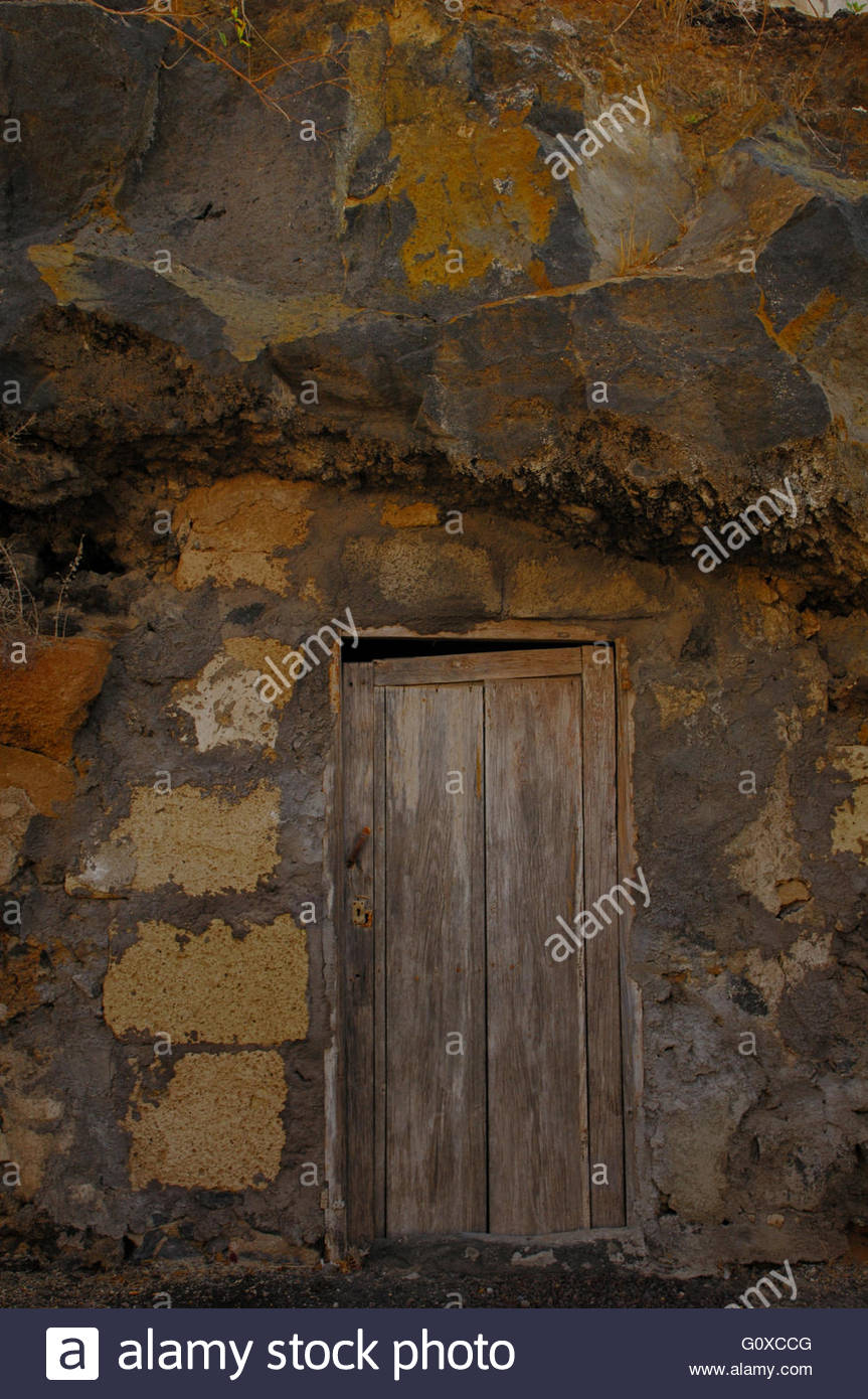 Door Closed To The Entrance Of A Cave Which Has Been Bricked Up With  Sandstone Blocks And Roughly Cemented. Tenerife, Canary Isl