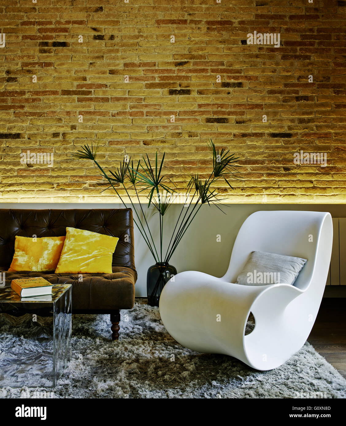 Nou De La Rambla Apartment Barcelona Spain Partial View Of Contemporary Living Room With Exposed Brick Wall And Leather Brown Couch