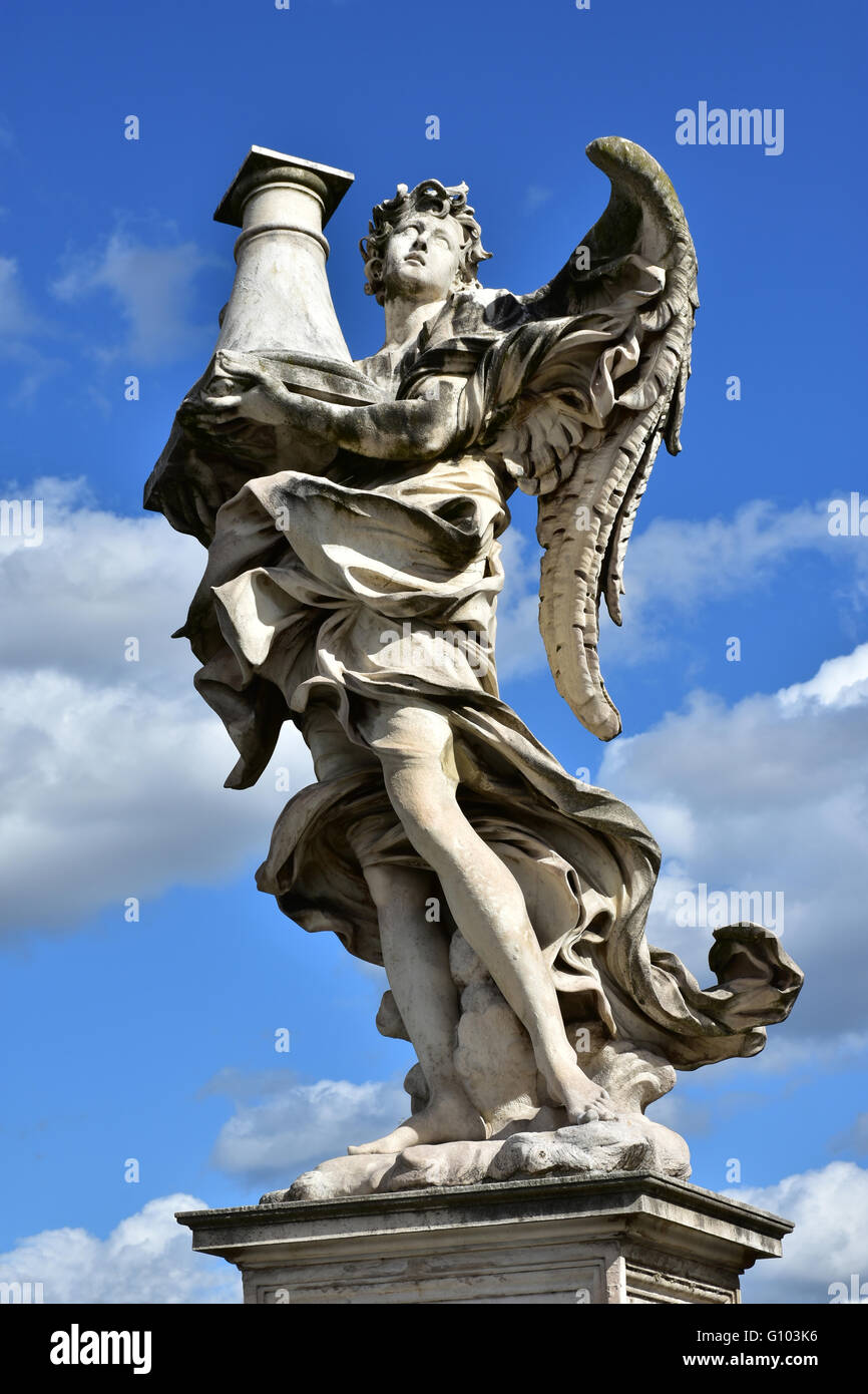 detail of an angel marble statue holding a column at the top of