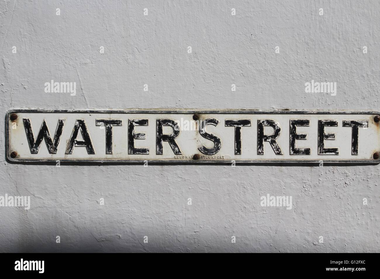 White Metal Letters Old Metal Street Sign With Black Letters On A White Background