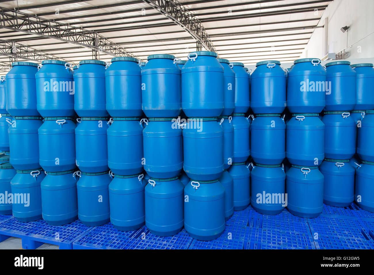 blue plastic barrels contain