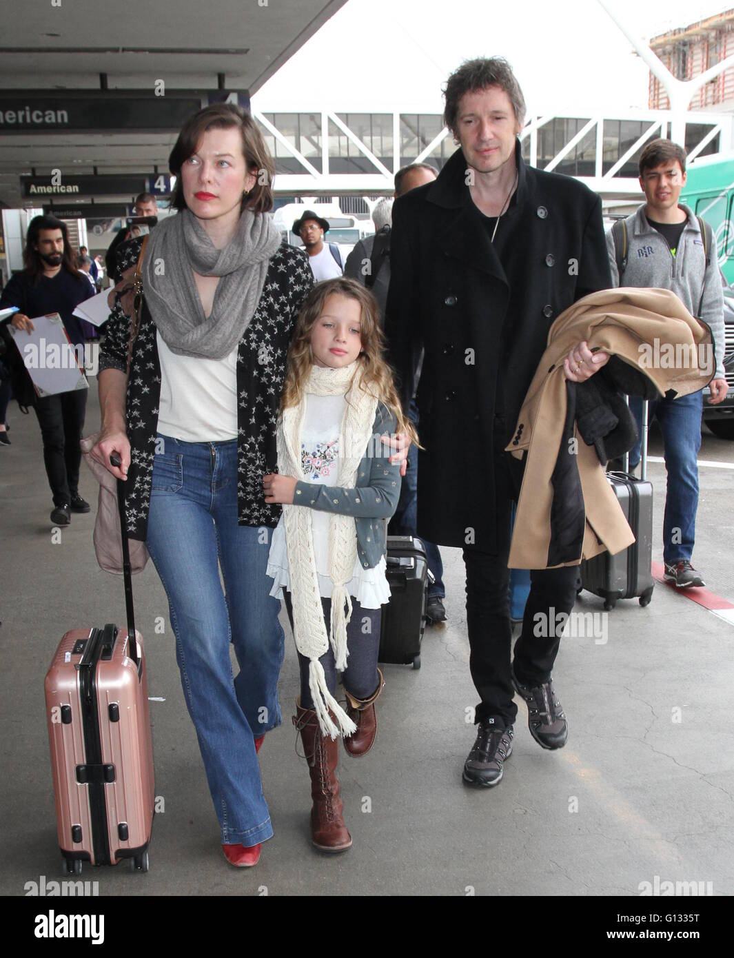 Milla Jovovich with Paul W. S. Anderson and daughter Ever Gabo Anderson at Los Angeles International Airport (LAX)  Featuring: Milla Jovovich, Paul W. S. Anderson, Ever Gabo Anderson Where: Los Angeles, California, United States When: 07 Apr 2016