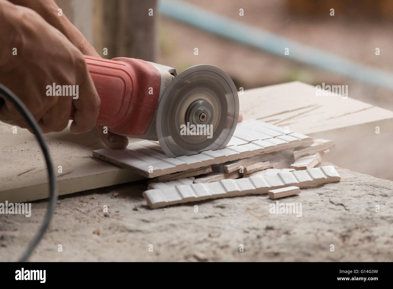 Cutting floor tiles with angle grinder