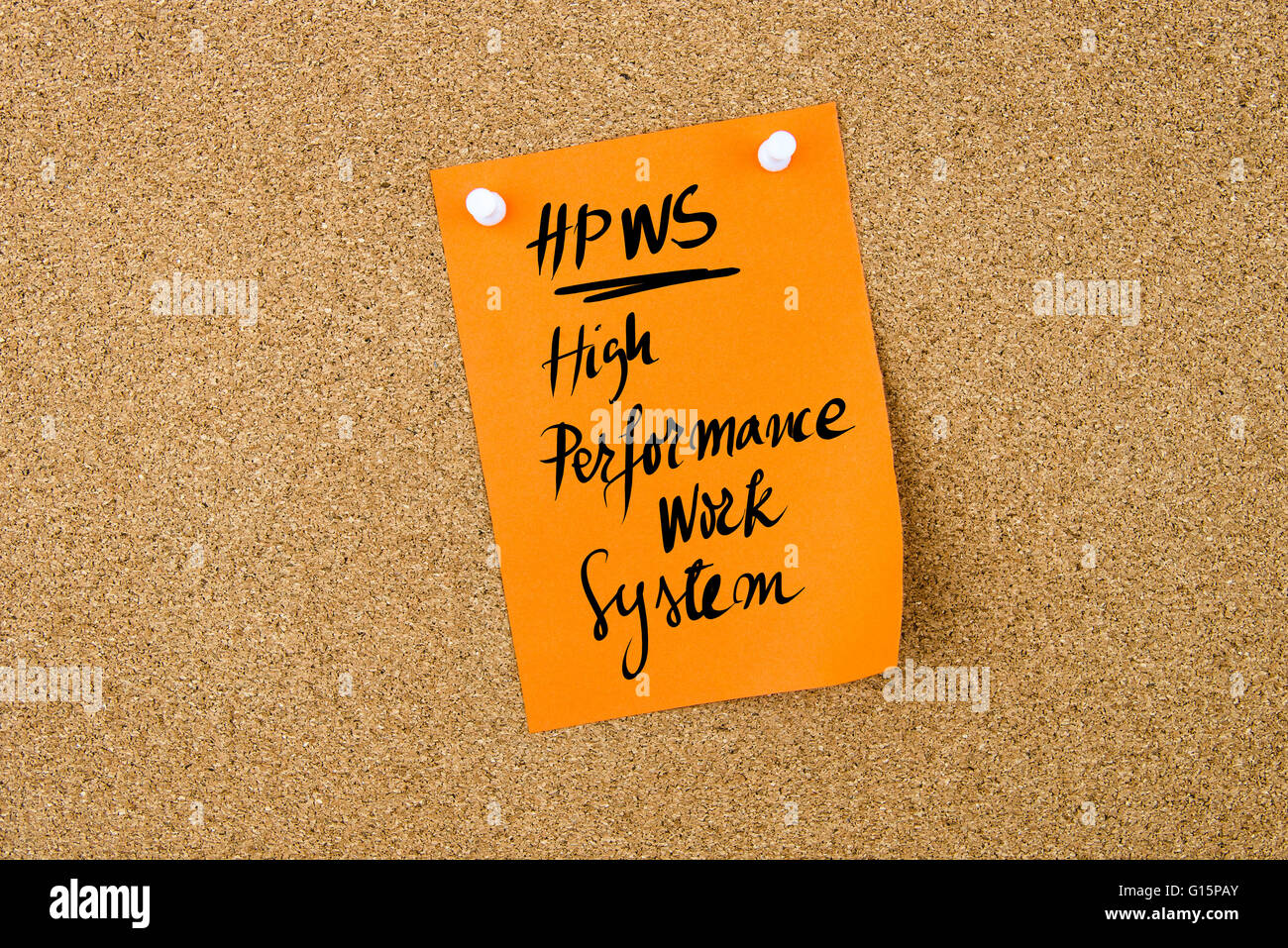 business acronym hpws high performance work system written on business acronym hpws high performance work system written on orange paper note pinned on cork board white thumbtack copy
