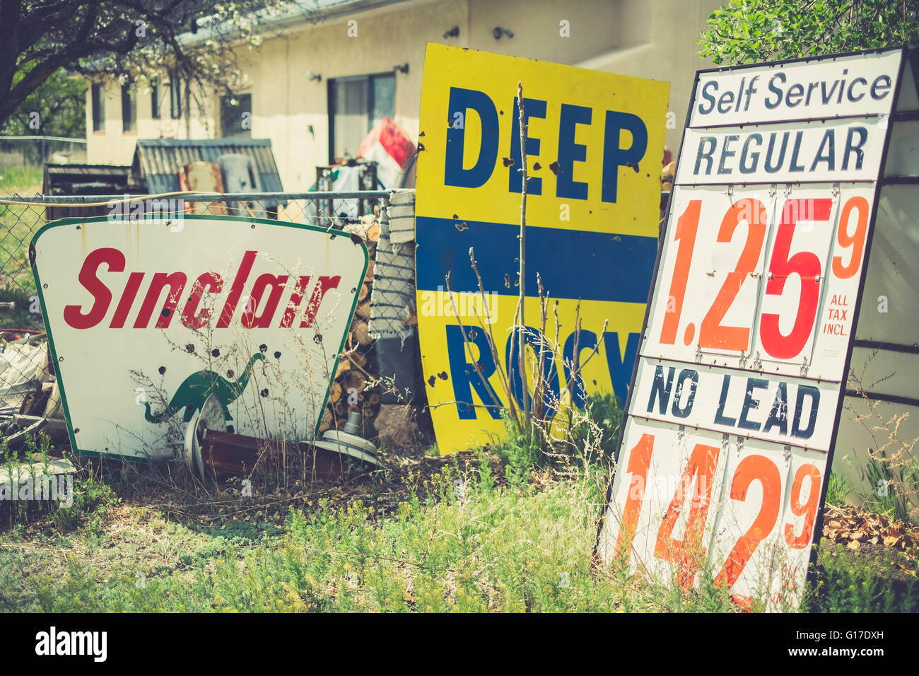Gas Prices In California >> Vintage gas station signs on ground with cheap regular and no lead Stock Photo, Royalty Free ...