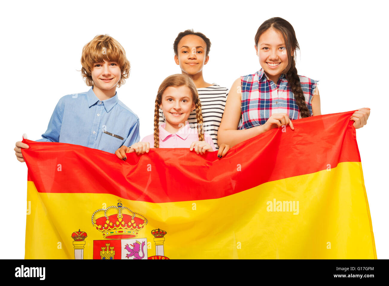 happy multiethnic teenage kids with flag of spain stock photo