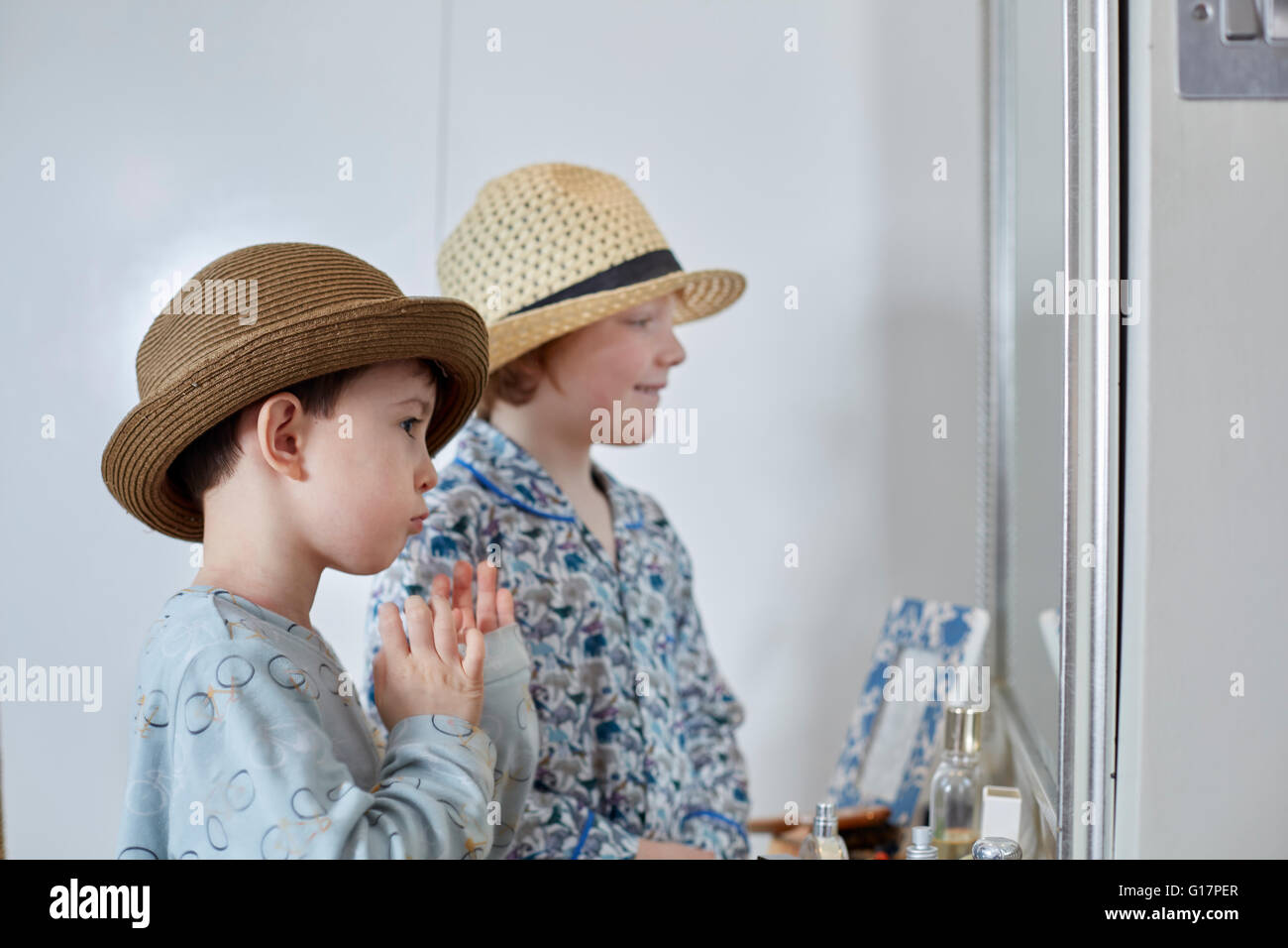 Boys playing dressup in bedroom Stock Photo Royalty Free Image