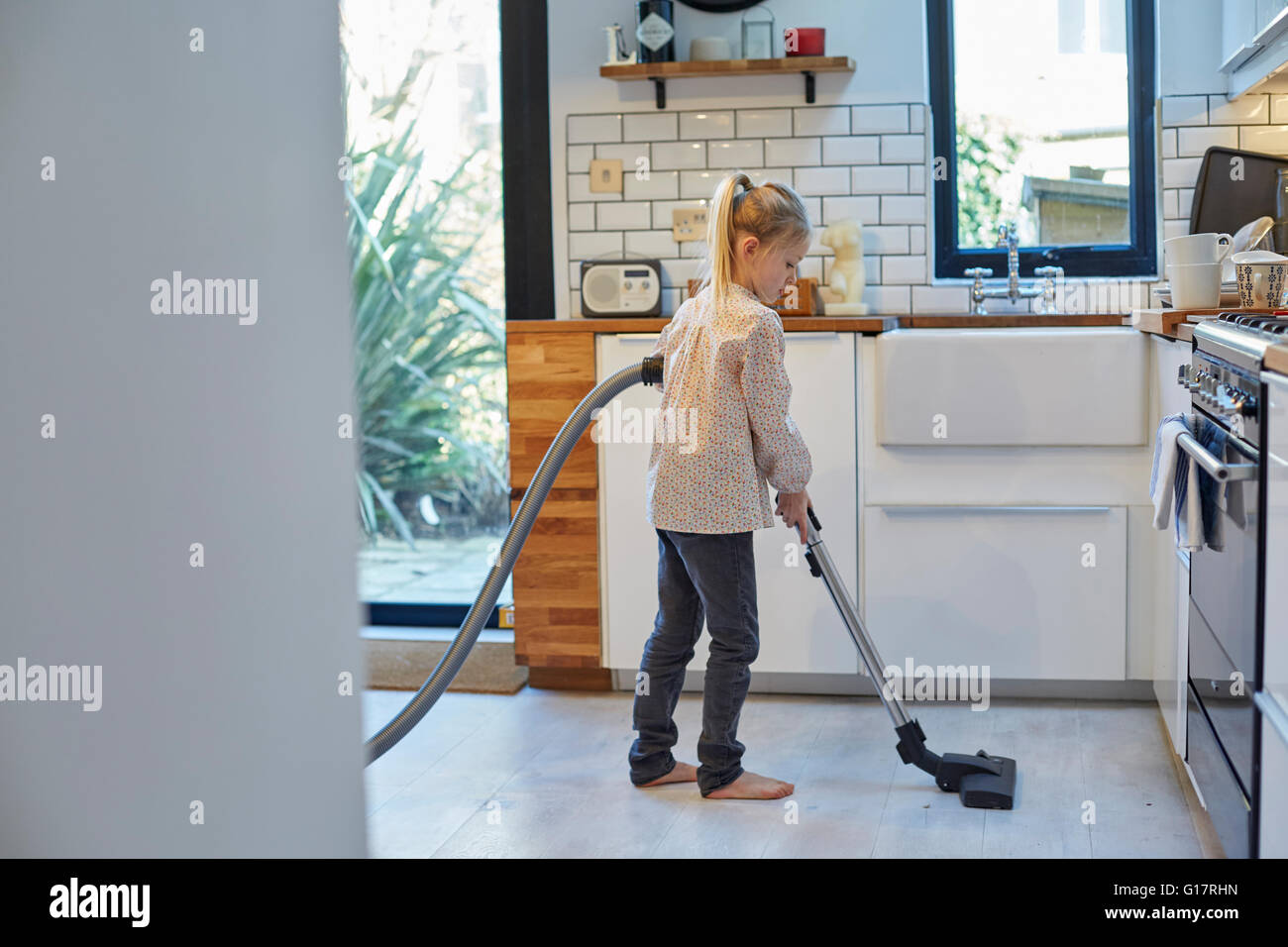 Kitchen Floor Vacuum Girl Vacuuming Kitchen Floor Stock Photo Royalty Free Image