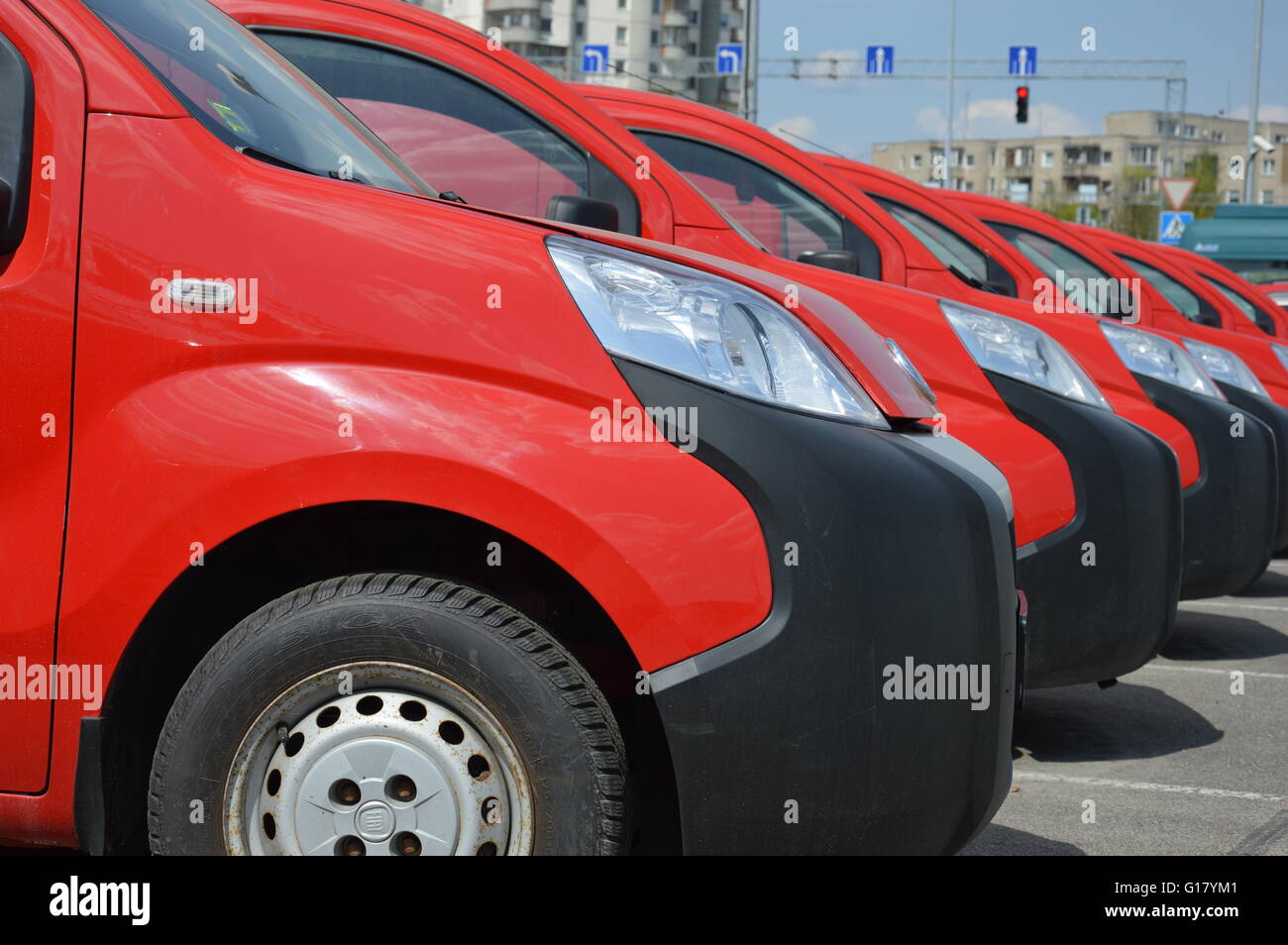 Row of red unused cars Stock Photo, Royalty Free Image: 104052257 ...