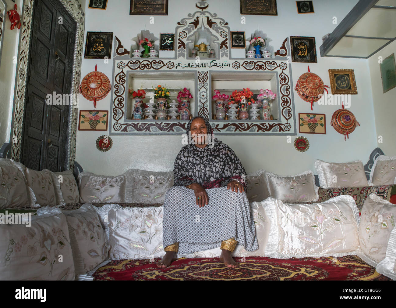 Ethiopian woman inside her decorated harari house