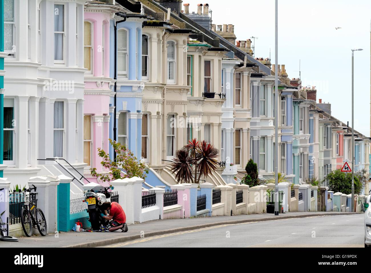 Brightly painted terraced houses on queens park road for Brighton house