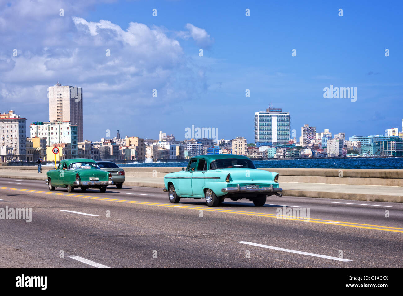 Blue old classic cars on the Malecon, the seafront promenade in ...