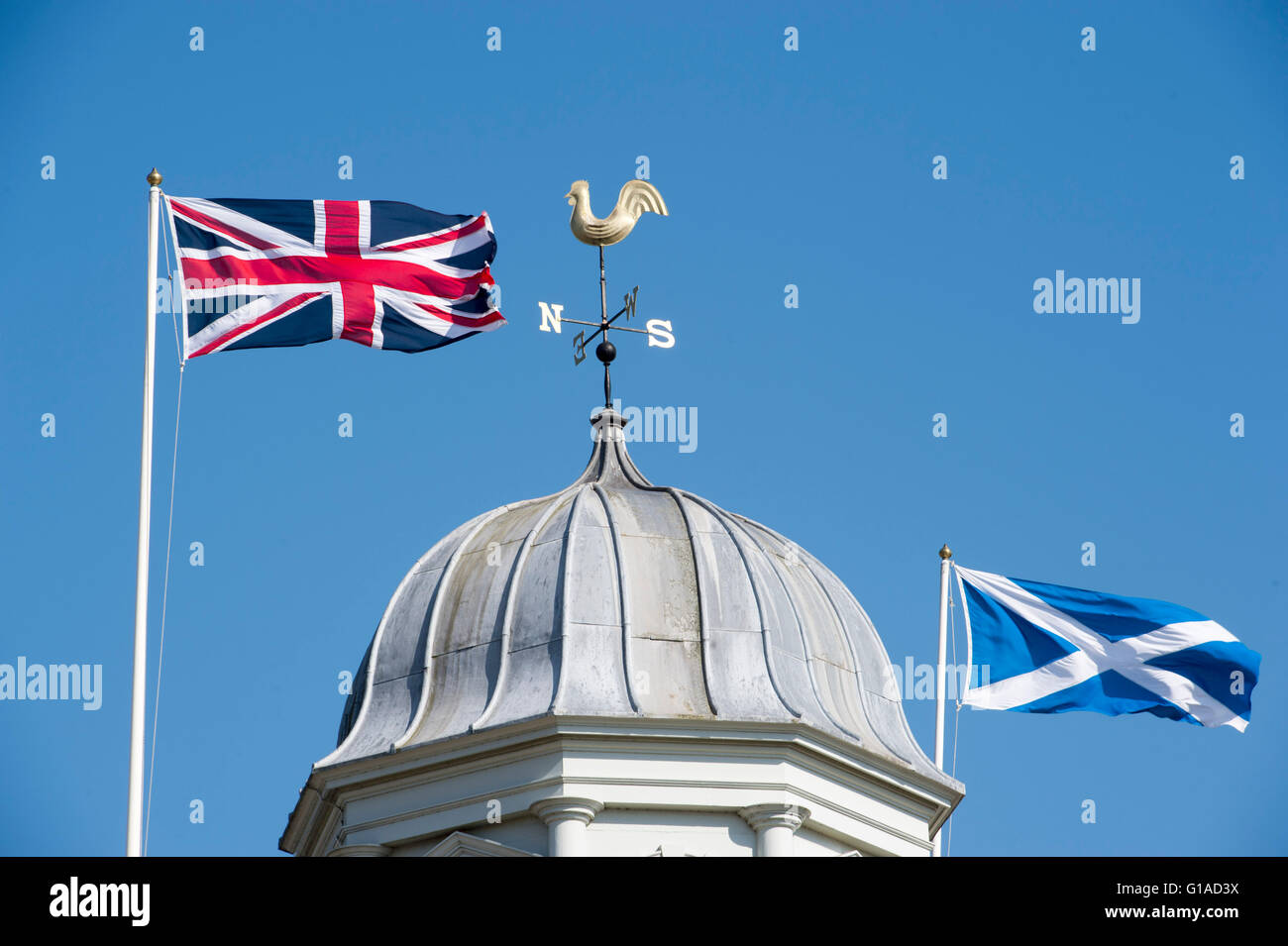union jack and scottish saltire flags flying side by side above